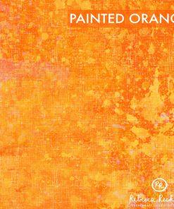 Produktfoto. Orangener Stoff mit Farbklecksen